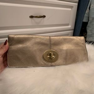 Coach vintage gold clutch used